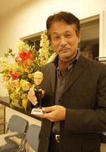 ティム・ガンの声を担当する、声優の田中正彦さん